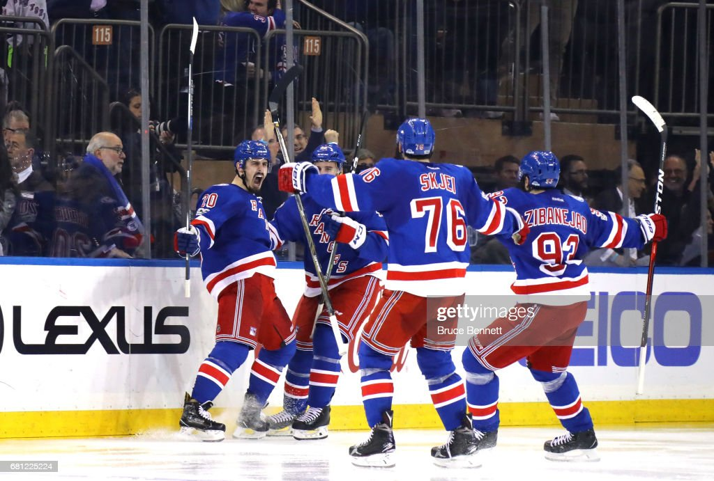 Chris Kreider #20 of the New York Rangers celebrates with his teammates Brendan Smith #42, Brady Skjei #76 and Mika Zibanejad #93 after scoring a goal against Craig Anderson #41 of the Ottawa Senators during the third period in Game Six of the Eastern Conference Second Round during the 2017 NHL Stanley Cup Playoffs at Madison Square Garden on May 9, 2017 in New York City.