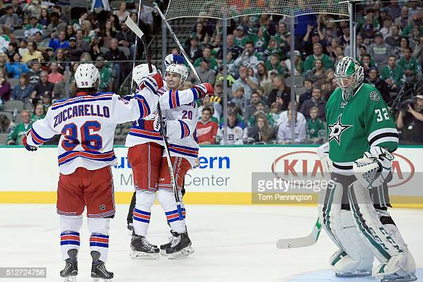 Chris Kreider of the New York Rangers celebrates with Mats Zuccarello of the New York Rangers and Derick Brassard of the New York Rangers after...
