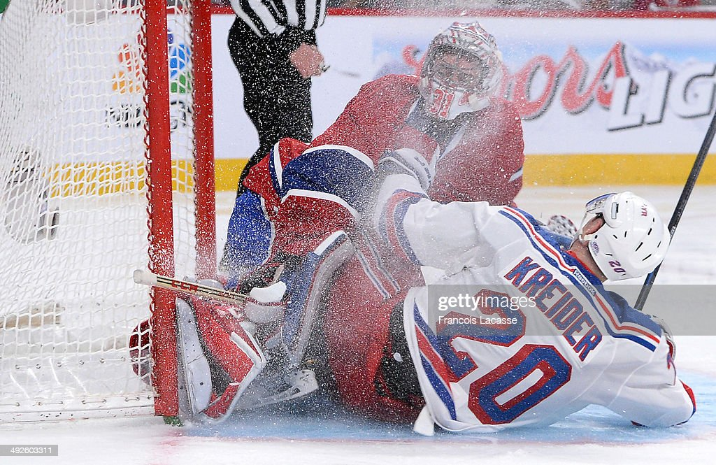 Chris Kreider #20 of the New York Rangers collides with Carey Price #31 of the Montreal Canadiens in Game One of the Eastern Conference Final during the 2014 Stanley Cup Playoffs at the Bell Centre on May 17, 2014 in Montreal, Quebec, Canada.