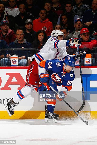 Chris Kreider of the New York Rangers collides with Mikhail Grabovski of the New York Islanders during the game at the Barclays Center on December 2...