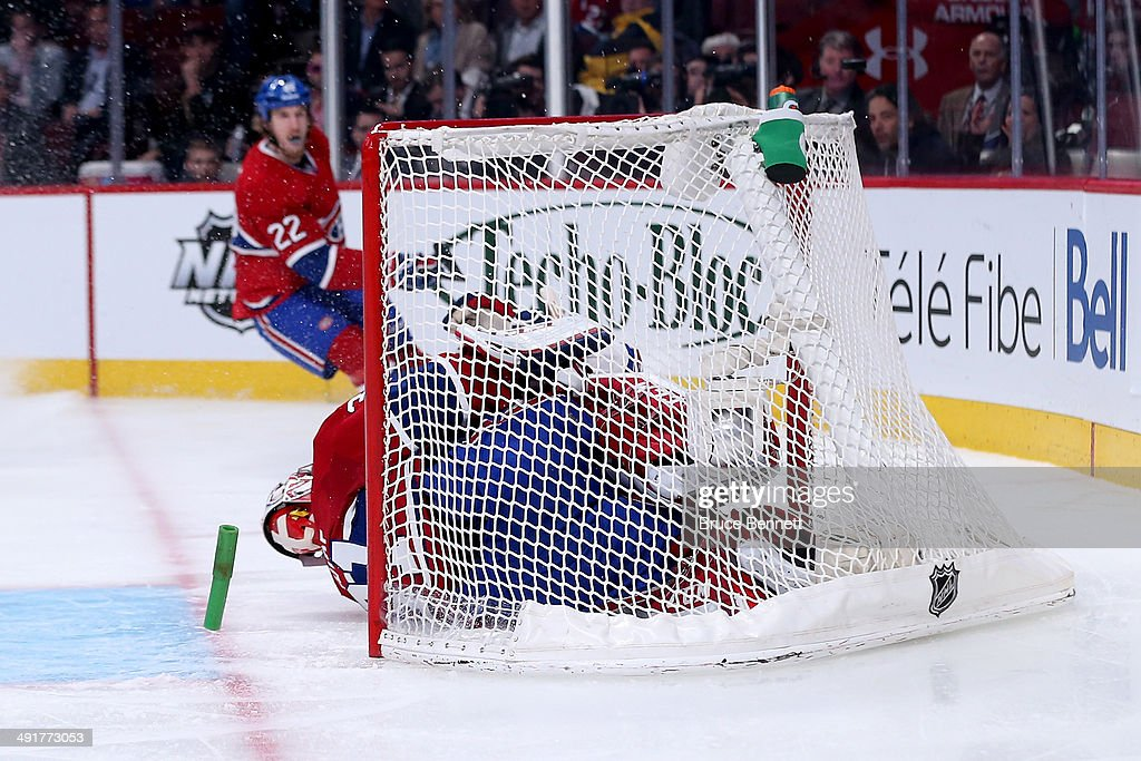 Chris Kreider #20 of the New York Rangers crashes into Carey Price #31 of the Montreal Canadiens and dislodges the net in the second period in Game One of the Eastern Conference Finals of the 2014 NHL Stanley Cup Playoffs at the Bell Centre on May 17, 2014 in Montreal, Canada.