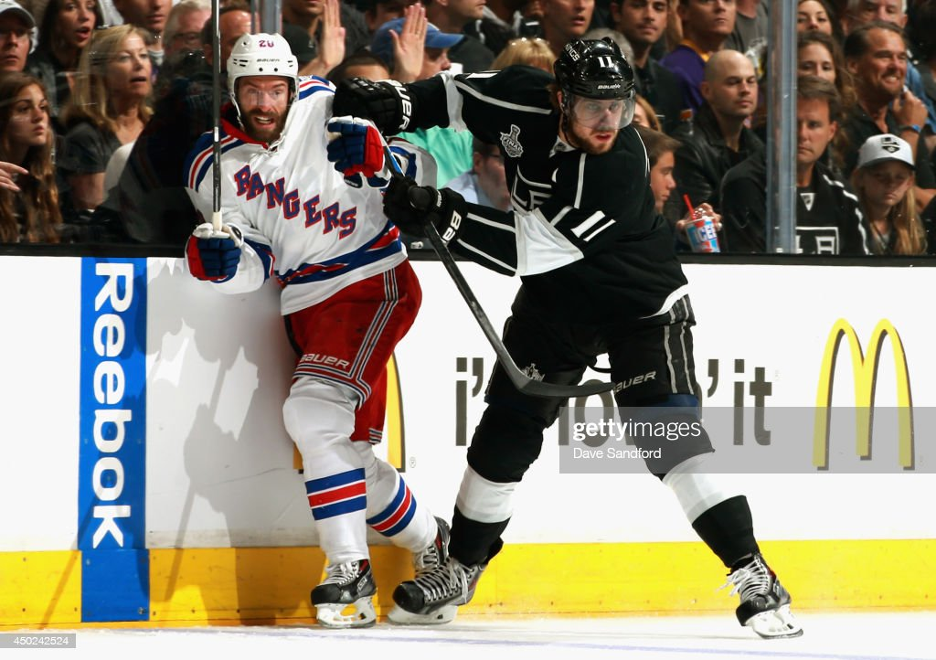 Chris Kreider of the New York Rangers is checked by Anze Kopitar of the Los Angeles Kings during the first period of Game Two of the 2014 Stanley Cup...