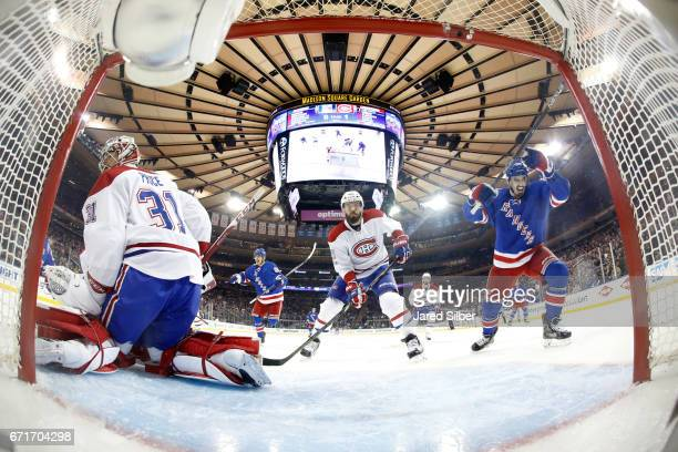 Chris Kreider of the New York Rangers reacts after a goal by Mats Zuccarello in the second period against Carey Price of the Montreal Canadiens in...