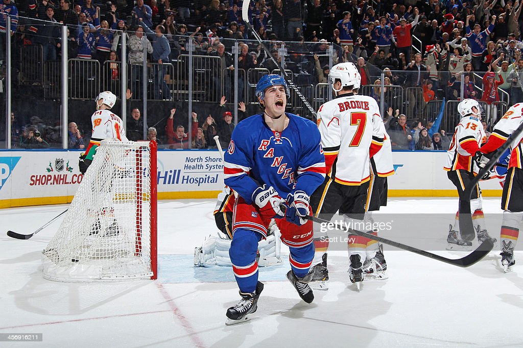 Chris Kreider #20 of the New York Rangers reacts after scoring a goal in the third period against the Calgary Flames at Madison Square Garden on December 15, 2013 in New York City.
