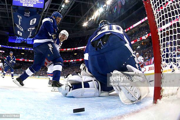 Chris Kreider of the New York Rangers scores a goal against Ben Bishop of the Tampa Bay Lightning during the second period in Game Four of the...