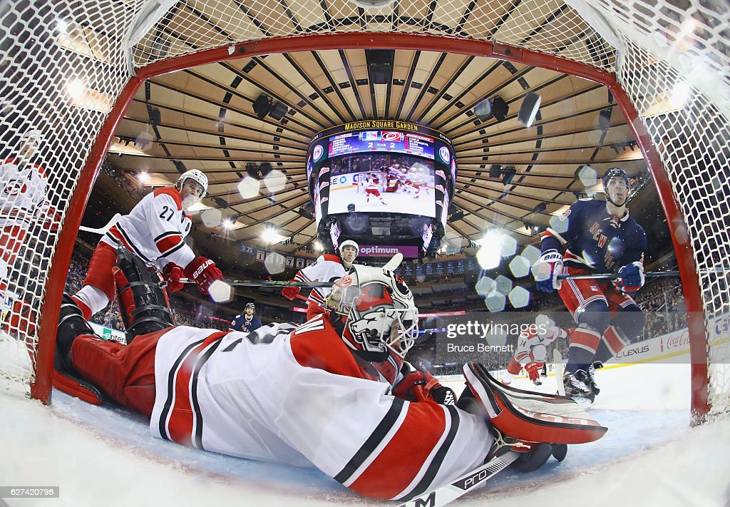 Chris Kreider #20 of the New York Rangers scores at 17:11 of the third period against Michael Leighton #32 of the Carolina Hurricanes Carolina Hurricanes at Madison Square Garden on December 3, 2016 in New York City. The Rangers defeated the Hurricanes 4-2.