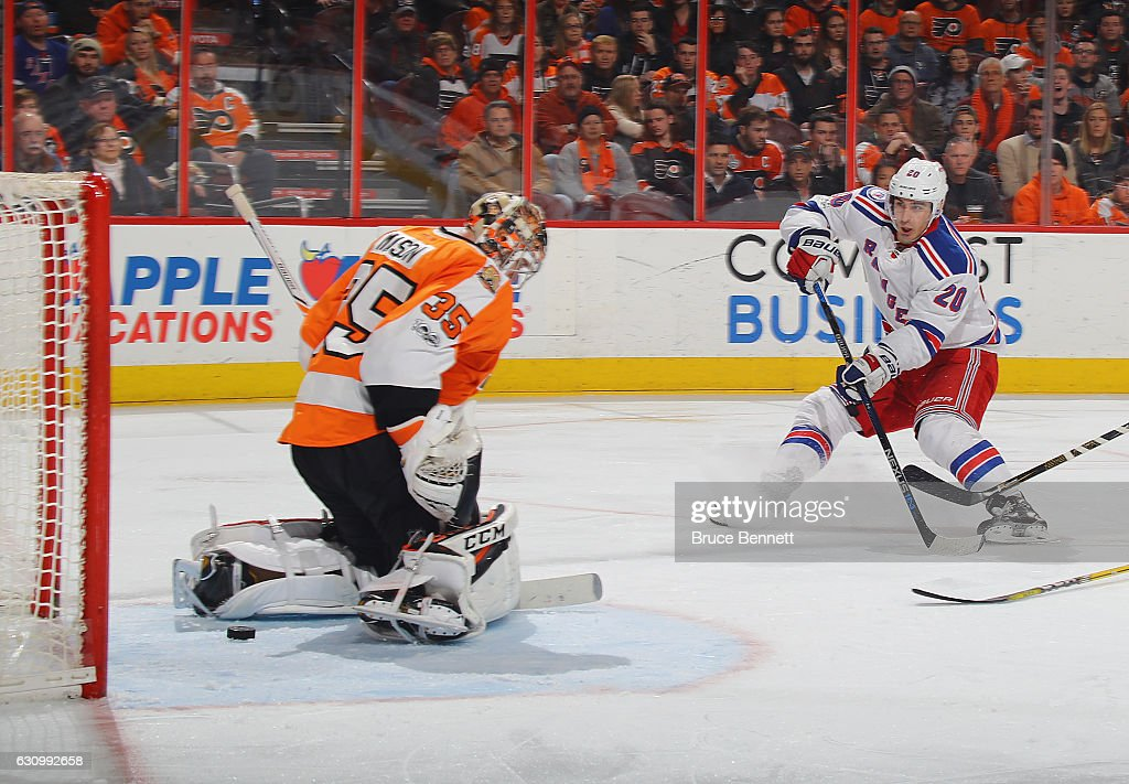 Chris Kreider #20 of the New York Rangers scores at 5:01 of the third period against Steve Mason #35 of the Philadelphia Flyers at the Wells Fargo Center on January 4, 2017 in Philadelphia, Pennsylvania. The Rangers defeated the Flyers 5-2.