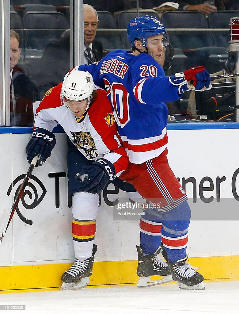 Chris Kreider #20 of the New York Rangers tries to stop Jonathan Huberdeau #11 of the Florida Panthers during the third period of an NHL hockey game at Madison Square Garden on March 21, 2013 in New York City. Panthers won 3-1.
