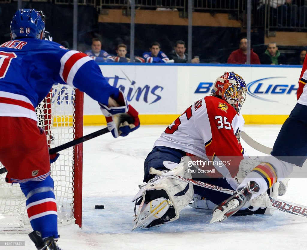 Chris Kreider #20 of the New York Rangers watches a shot slide through the goal crease harmlessly behind goalie Jacob Markstrom #35 of the Florida Panthers in the second period of an NHL hockey game at Madison Square Garden on March 21, 2013 in New York City.