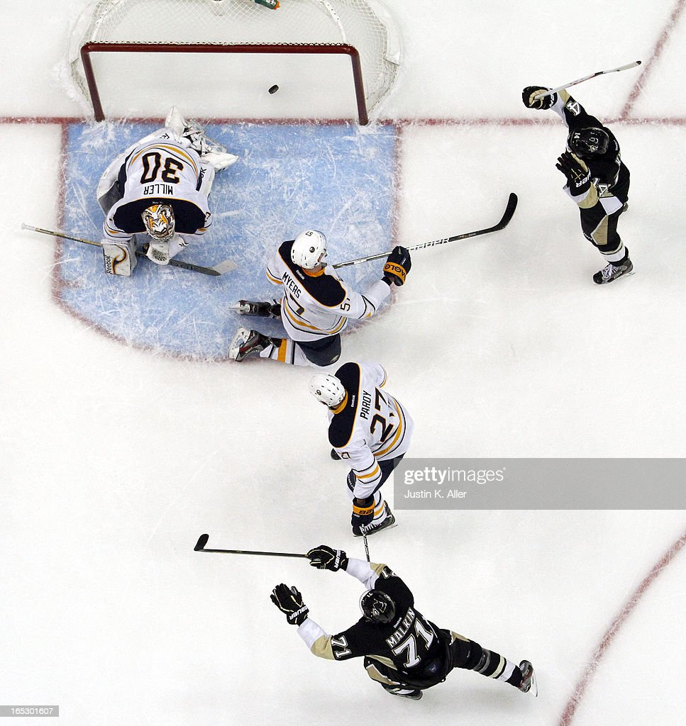 <a gi-track='captionPersonalityLinkClicked' href=/galleries/search?phrase=Chris+Kunitz&family=editorial&specificpeople=604159 ng-click='$event.stopPropagation()'>Chris Kunitz</a> #14 and <a gi-track='captionPersonalityLinkClicked' href=/galleries/search?phrase=Evgeni+Malkin&family=editorial&specificpeople=221676 ng-click='$event.stopPropagation()'>Evgeni Malkin</a> #71 of the Pittsburgh Penguins celebrates <a gi-track='captionPersonalityLinkClicked' href=/galleries/search?phrase=Jarome+Iginla&family=editorial&specificpeople=201792 ng-click='$event.stopPropagation()'>Jarome Iginla</a>'s #12 (not pictured) first goal as a Penguin against the Buffalo Sabres during the game at Consol Energy Center on April 2, 2013 in Pittsburgh, Pennsylvania. The Sabres defeated the Penguins 4-1.