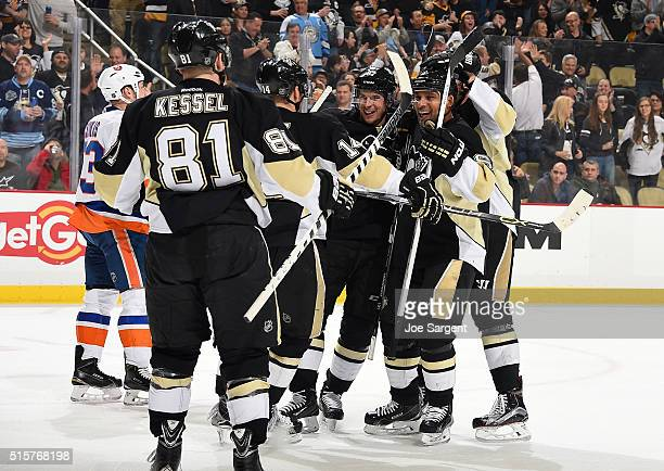 Chris Kunitz celebrates his goal with Sidney Crosby and Trevor Daley of the Pittsburgh Penguins during the first period against the New York...