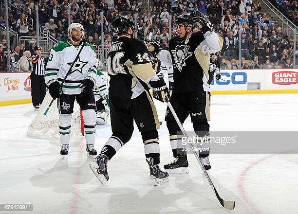 Chris Kunitz celebrates his goal with Sidney Crosby of the Pittsburgh Penguins in front of Alex Goligoski of the Dallas Stars on March 18 2014 at...
