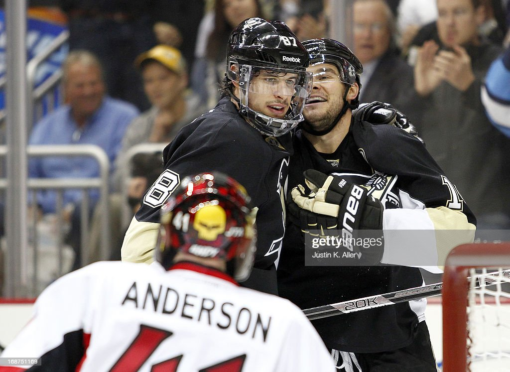 Chris Kunitz #14 celebrates with Sidney Crosby #87 of the Pittsburgh Penguins after scoring in the second period against Craig Anderson #41 of the Ottawa Senators in Game One of the Eastern Conference Semifinals during the 2013 NHL Stanley Cup Playoffs at Consol Energy Center on May 14, 2013 in Pittsburgh, Pennsylvania.