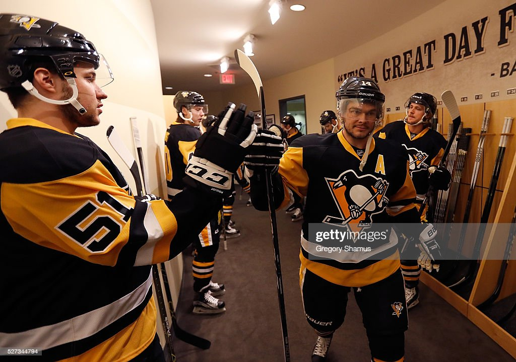 Chris Kunitz #14 fist bumps Derrick Pouliot #51 of the Pittsburgh Penguins prior to the game against the Washington Capitals in Game Three of the Eastern Conference Second Round during the 2016 NHL Stanley Cup Playoffs at Consol Energy Center on May 2, 2016 in Pittsburgh, Pennsylvania.