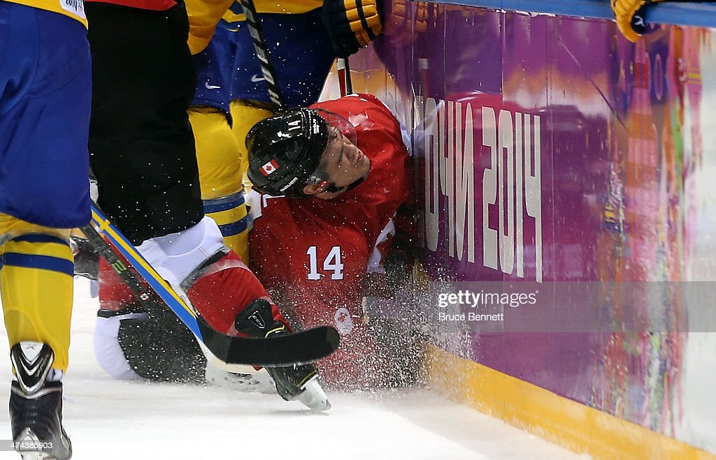 <a gi-track='captionPersonalityLinkClicked' href=/galleries/search?phrase=Chris+Kunitz&family=editorial&specificpeople=604159 ng-click='$event.stopPropagation()'>Chris Kunitz</a> #14 of Canada crashes into the boards during the Men's Ice Hockey Gold Medal match against Sweden on Day 16 of the 2014 Sochi Winter Olympics at Bolshoy Ice Dome on February 23, 2014 in Sochi, Russia.