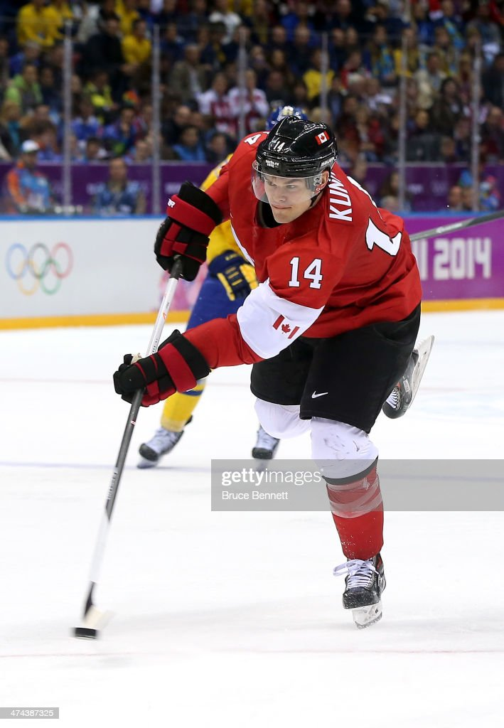 Chris Kunitz of Canada scores a thirdperiod goal against Sweden during the Men's Ice Hockey Gold Medal match on Day 16 of the 2014 Sochi Winter...