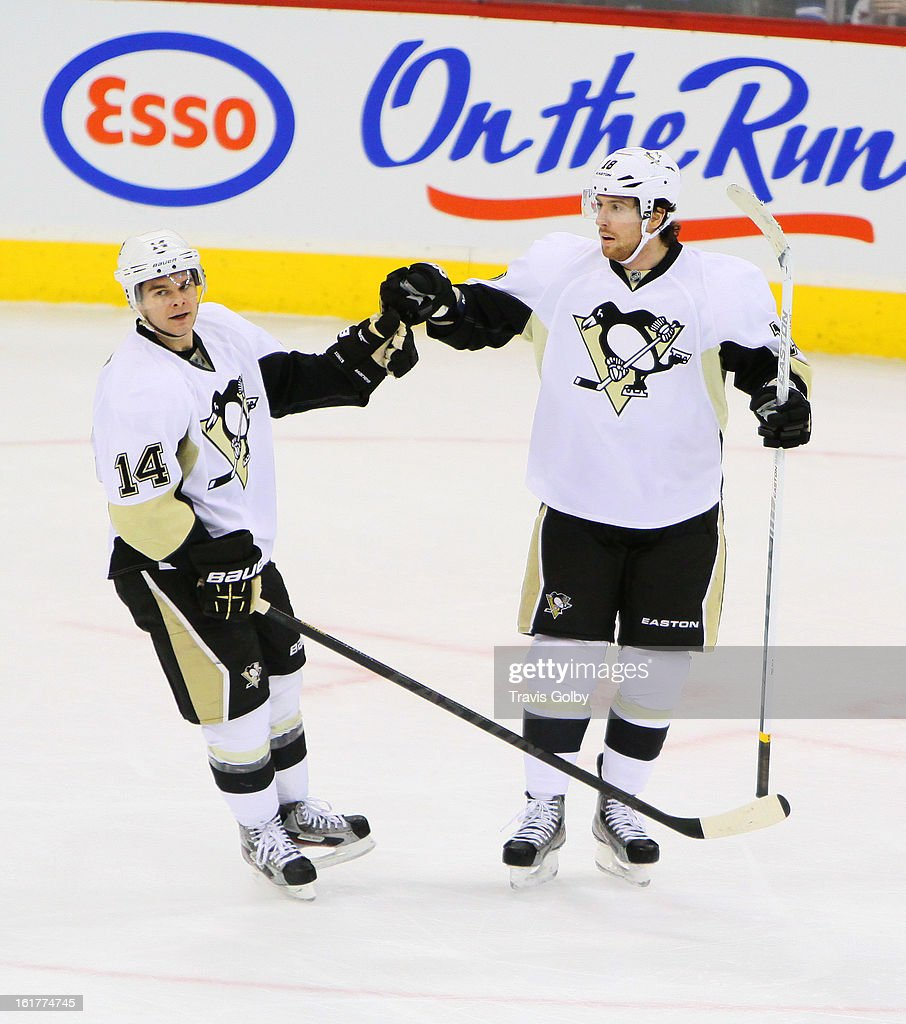 <a gi-track='captionPersonalityLinkClicked' href=/galleries/search?phrase=Chris+Kunitz&family=editorial&specificpeople=604159 ng-click='$event.stopPropagation()'>Chris Kunitz</a> #14 of the Pittsburgh Penguins bumps gloves with teammate <a gi-track='captionPersonalityLinkClicked' href=/galleries/search?phrase=James+Neal&family=editorial&specificpeople=1487991 ng-click='$event.stopPropagation()'>James Neal</a> #18 following a third period goal against the Winnipeg Jets at the MTS Centre on February 15, 2013 in Winnipeg, Manitoba, Canada.