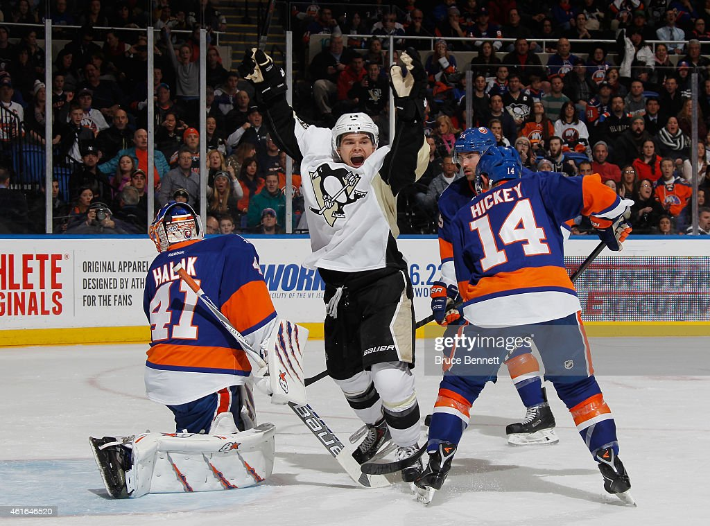 <a gi-track='captionPersonalityLinkClicked' href=/galleries/search?phrase=Chris+Kunitz&family=editorial&specificpeople=604159 ng-click='$event.stopPropagation()'>Chris Kunitz</a> #14 of the Pittsburgh Penguins celebrates a powerplay goal by David Perron #39 (not shown) at 12:22 of the second period against <a gi-track='captionPersonalityLinkClicked' href=/galleries/search?phrase=Jaroslav+Halak&family=editorial&specificpeople=2285591 ng-click='$event.stopPropagation()'>Jaroslav Halak</a> #41 of the New York Islanders at the Nassau Veterans Memorial Coliseum on January 16, 2015 in Uniondale, New York.