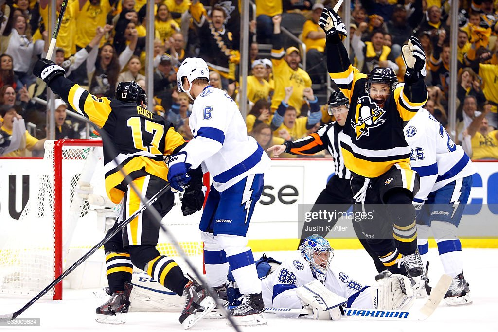 <a gi-track='captionPersonalityLinkClicked' href=/galleries/search?phrase=Chris+Kunitz&family=editorial&specificpeople=604159 ng-click='$event.stopPropagation()'>Chris Kunitz</a> #14 of the Pittsburgh Penguins celebrates after scoring a goal against <a gi-track='captionPersonalityLinkClicked' href=/galleries/search?phrase=Andrei+Vasilevskiy+-+Ice+Hockey+Player&family=editorial&specificpeople=9594320 ng-click='$event.stopPropagation()'>Andrei Vasilevskiy</a> #88 of the Tampa Bay Lightning during the second period in Game Five of the Eastern Conference Final during the 2016 NHL Stanley Cup Playoffs at Consol Energy Center on May 22, 2016 in Pittsburgh, Pennsylvania.