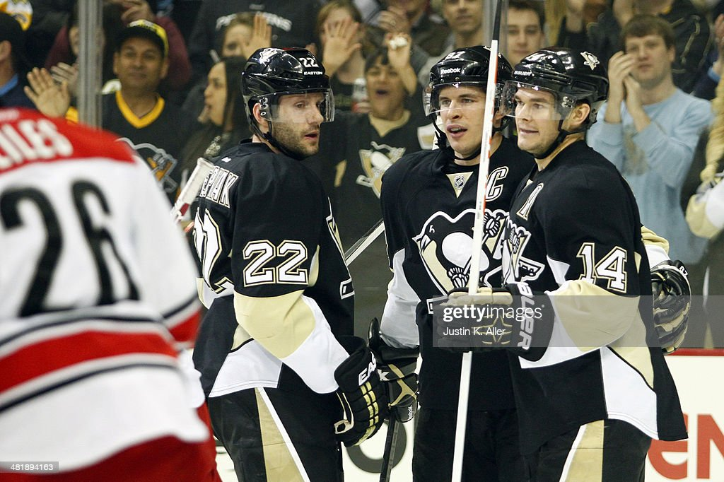 Chris Kunitz #14 of the Pittsburgh Penguins celebrates his first period goal against the Carolina Hurricanes during the game at Consol Energy Center on April 1, 2014 in Pittsburgh, Pennsylvania.