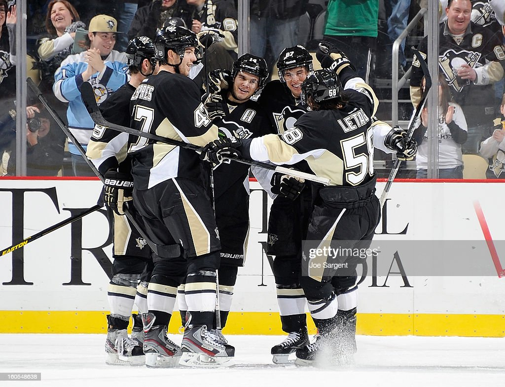 <a gi-track='captionPersonalityLinkClicked' href=/galleries/search?phrase=Chris+Kunitz&family=editorial&specificpeople=604159 ng-click='$event.stopPropagation()'>Chris Kunitz</a> #14 of the Pittsburgh Penguins celebrates his goal with Robert Bortuzzo #41, <a gi-track='captionPersonalityLinkClicked' href=/galleries/search?phrase=Sidney+Crosby&family=editorial&specificpeople=212781 ng-click='$event.stopPropagation()'>Sidney Crosby</a> #87 and <a gi-track='captionPersonalityLinkClicked' href=/galleries/search?phrase=Kris+Letang&family=editorial&specificpeople=3966336 ng-click='$event.stopPropagation()'>Kris Letang</a> #58 during the second period against the New Jersey Devils on February 2, 2013 at Consol Energy Center in Pittsburgh, Pennsylvania.