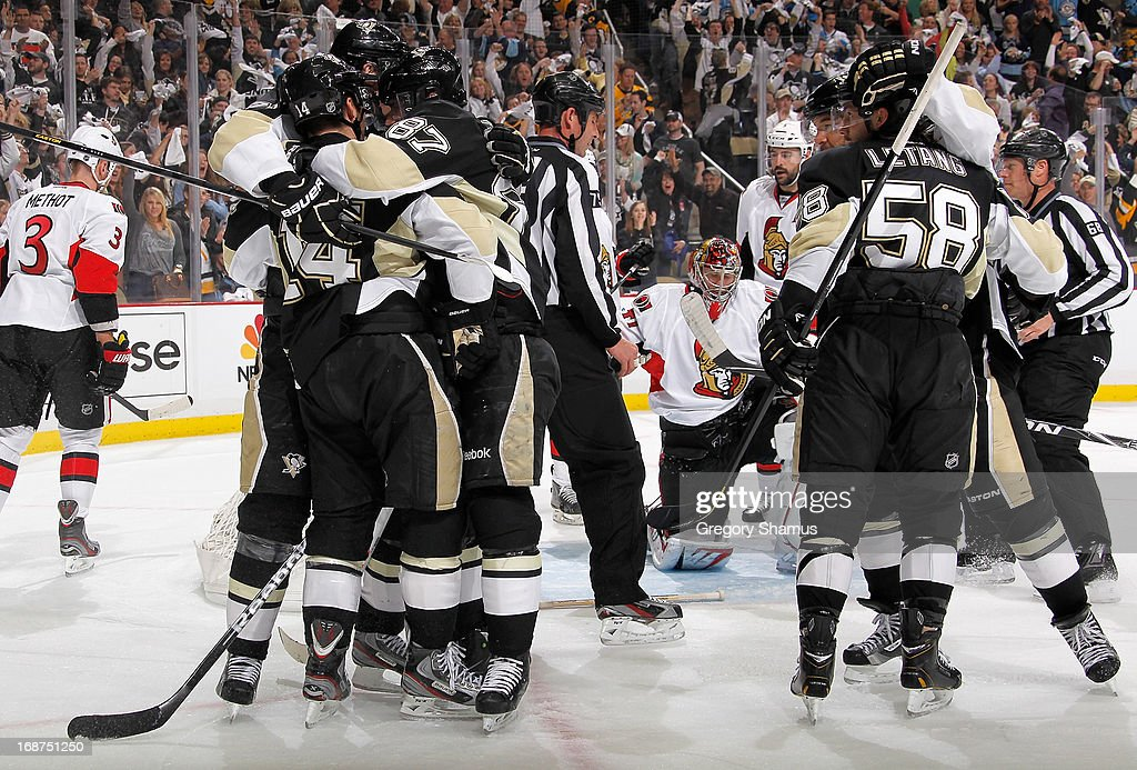 Chris Kunitz #14 of the Pittsburgh Penguins celebrates his goal with teammates during the second period against the Ottawa Senators in Game One of the Eastern Conference Semifinals during the 2013 NHL Stanley Cup Playoffs at Consol Energy Center on May 14, 2013 in Pittsburgh, Pennsylvania.