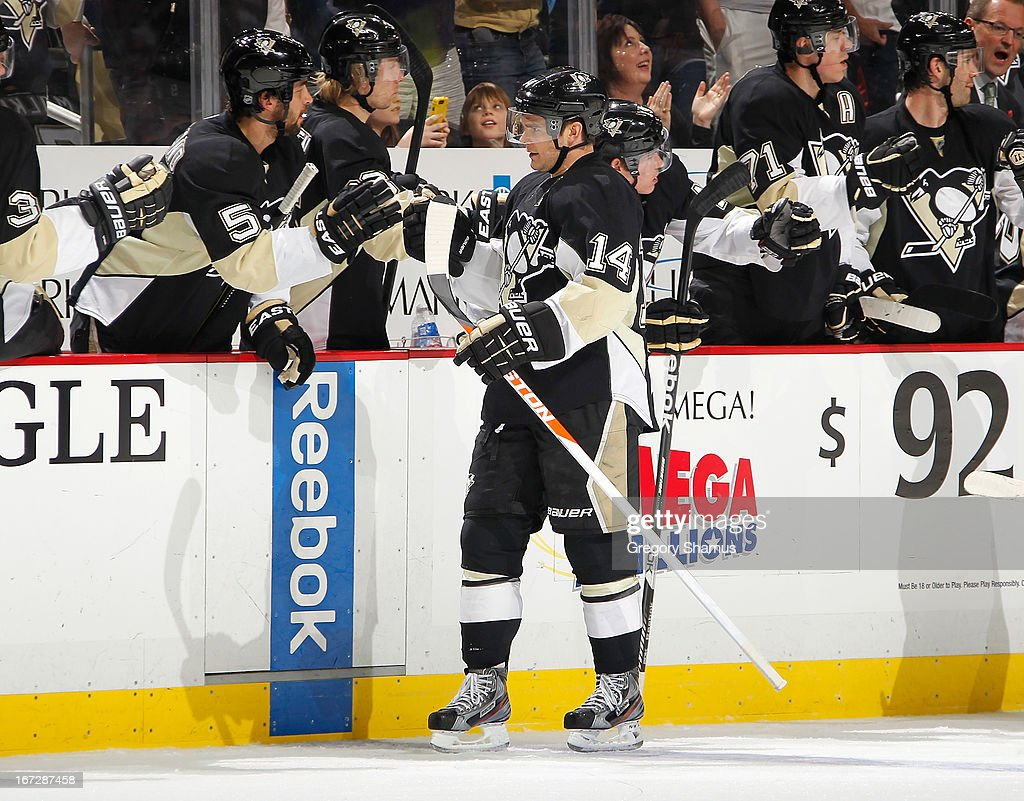 Chris Kunitz #14 of the Pittsburgh Penguins celebrates his goal with the bench during the game against the Buffalo Sabres on April 23, 2013 at Consol Energy Center in Pittsburgh, Pennsylvania.