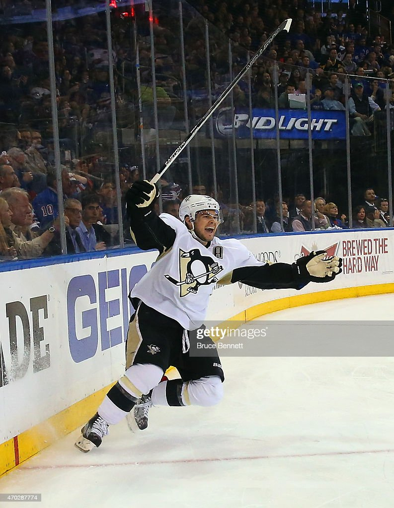 <a gi-track='captionPersonalityLinkClicked' href=/galleries/search?phrase=Chris+Kunitz&family=editorial&specificpeople=604159 ng-click='$event.stopPropagation()'>Chris Kunitz</a> #14 of the Pittsburgh Penguins celebrates his power play goal at 9:41 of the third period against the New York Rangers in Game One of the Eastern Conference Quarterfinals during the 2015 NHL Stanley Cup Playoffs at Madison Square Garden on April 18, 2015 in New York City. The Penguins defeated the Rangers 4-3.