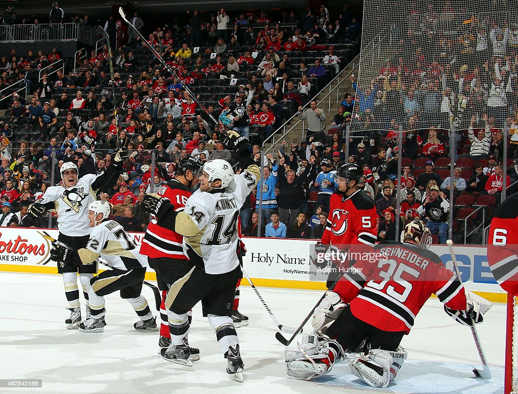<a gi-track='captionPersonalityLinkClicked' href=/galleries/search?phrase=Chris+Kunitz&family=editorial&specificpeople=604159 ng-click='$event.stopPropagation()'>Chris Kunitz</a> #14 of the Pittsburgh Penguins celebrates scoring a goal on <a gi-track='captionPersonalityLinkClicked' href=/galleries/search?phrase=Cory+Schneider&family=editorial&specificpeople=696908 ng-click='$event.stopPropagation()'>Cory Schneider</a> #35 of the New Jersey Devils during the third period at the Prudential Center on January 30, 2015 in Newark, New Jersey.