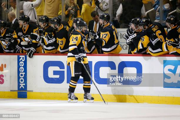 Chris Kunitz of the Pittsburgh Penguins celebrates with his teammates after scoring a goal against Craig Anderson of the Ottawa Senators during the...