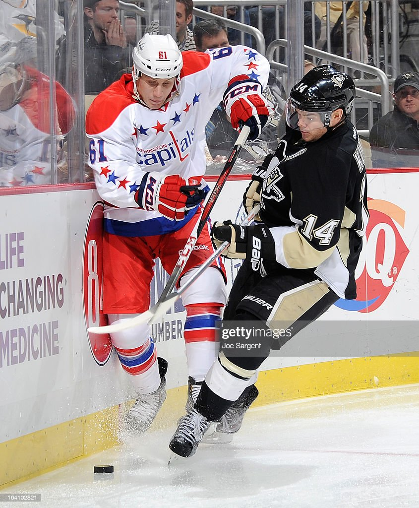 Chris Kunitz #14 of the Pittsburgh Penguins collides with Steven Oleksy #61 of the Washington Capitals on March 19, 2013 at Consol Energy Center in Pittsburgh, Pennsylvania.