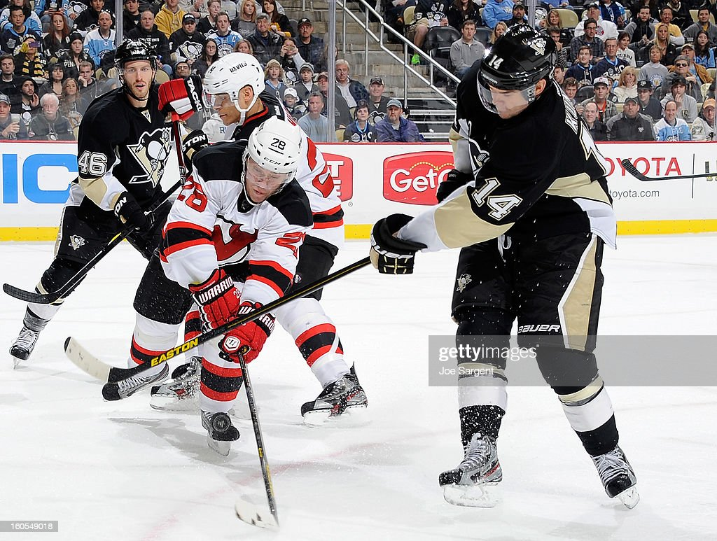 <a gi-track='captionPersonalityLinkClicked' href=/galleries/search?phrase=Chris+Kunitz&family=editorial&specificpeople=604159 ng-click='$event.stopPropagation()'>Chris Kunitz</a> #14 of the Pittsburgh Penguins has his shot blocked by <a gi-track='captionPersonalityLinkClicked' href=/galleries/search?phrase=Anton+Volchenkov&family=editorial&specificpeople=210890 ng-click='$event.stopPropagation()'>Anton Volchenkov</a> #28 of the New Jersey Devils on February 2, 2013 at Consol Energy Center in Pittsburgh, Pennsylvania.