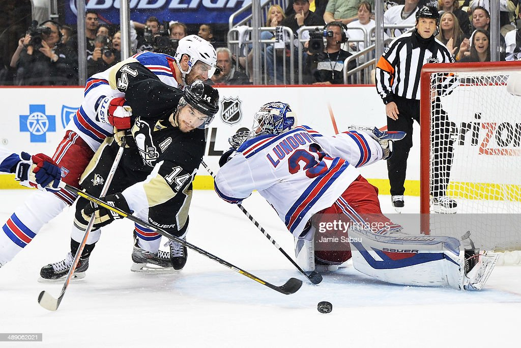 Chris Kunitz #14 of the Pittsburgh Penguins is held by Dan Girardi #5 of the New York Rangers as he attempts to shoot the puck past goaltender Henrik Lundqvist #30 of the New York Rangers during a power play in the second period in Game Five of the Second Round of the 2014 NHL Stanley Cup Playoffs on May 9, 2014 at CONSOL Energy Center in Pittsburgh, Pennsylvania. Girardi was assessed a holding penalty granting Pittsburgh a five on three power play.