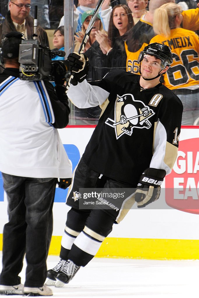 Chris Kunitz #14 of the Pittsburgh Penguins is named first star of the game after scoring two goals against the Edmonton Oilers on March 13, 2011 at CONSOL Energy Center in Pittsburgh, Pennsylvania. Pittsburgh defeated Edmonton 5-1.
