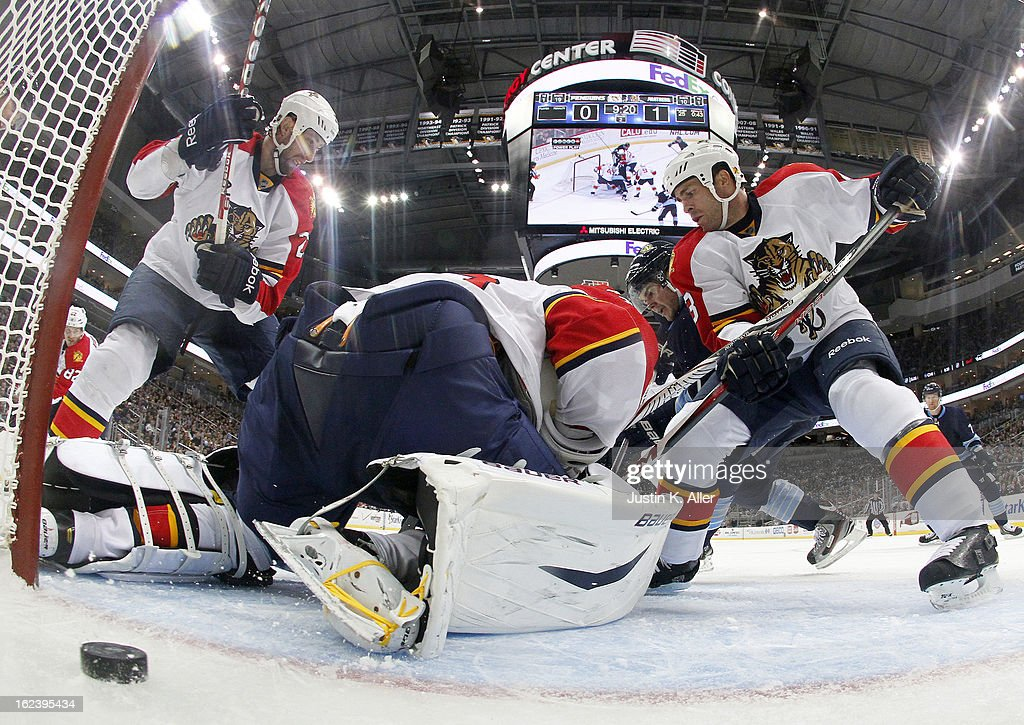 Chris Kunitz #14 of the Pittsburgh Penguins jams in a goal past Jacob Markstrom #35 of the Florida Panthers in the second period during the game at Consol Energy Center on February 22, 2013 in Pittsburgh, Pennsylvania. The Penguins won 3-1.