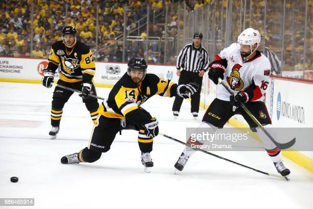 Chris Kunitz of the Pittsburgh Penguins looks for the puck against Clarke MacArthur of the Ottawa Senators in Game Five of the Eastern Conference...