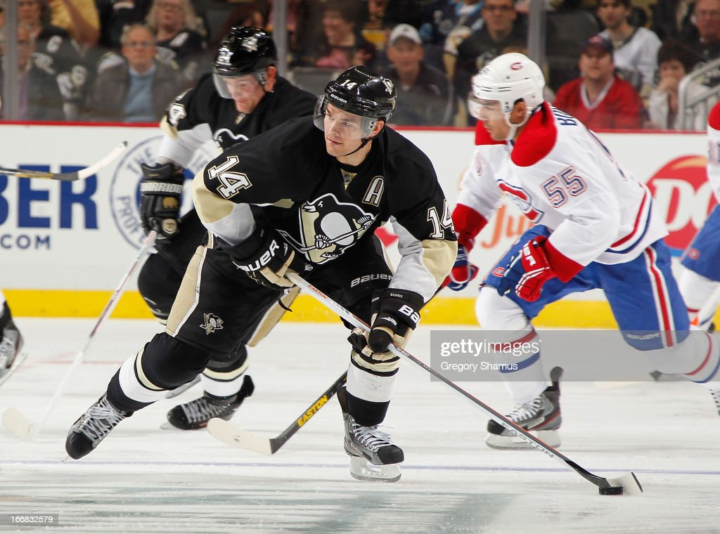 <a gi-track='captionPersonalityLinkClicked' href=/galleries/search?phrase=Chris+Kunitz&family=editorial&specificpeople=604159 ng-click='$event.stopPropagation()'>Chris Kunitz</a> #14 of the Pittsburgh Penguins moves the puck up ice in front of <a gi-track='captionPersonalityLinkClicked' href=/galleries/search?phrase=Francis+Bouillon&family=editorial&specificpeople=215165 ng-click='$event.stopPropagation()'>Francis Bouillon</a> #55 of the Montreal Canadiens on April17, 2013 at Consol Energy Center in Pittsburgh, Pennsylvania.