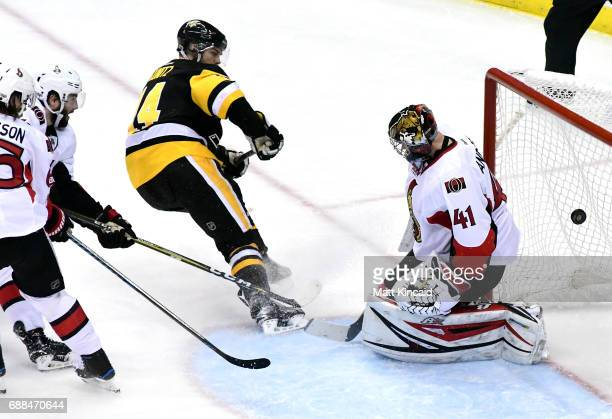 Chris Kunitz of the Pittsburgh Penguins scores a goal against Craig Anderson of the Ottawa Senators during the second period in Game Seven of the...