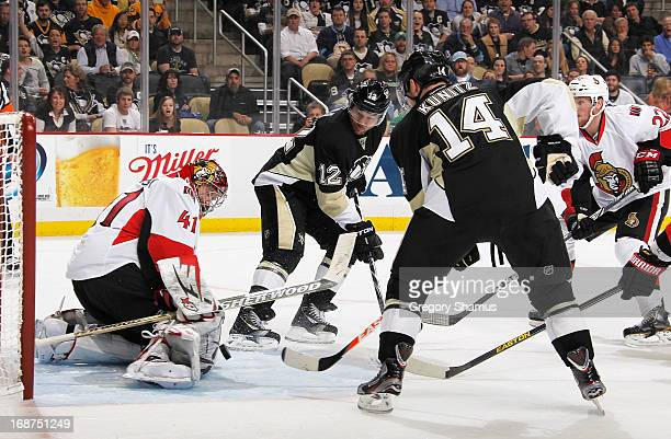 Chris Kunitz of the Pittsburgh Penguins scores past Craig Anderson of the Ottawa Senators in front of Jarome Iginla in Game One of the Eastern...