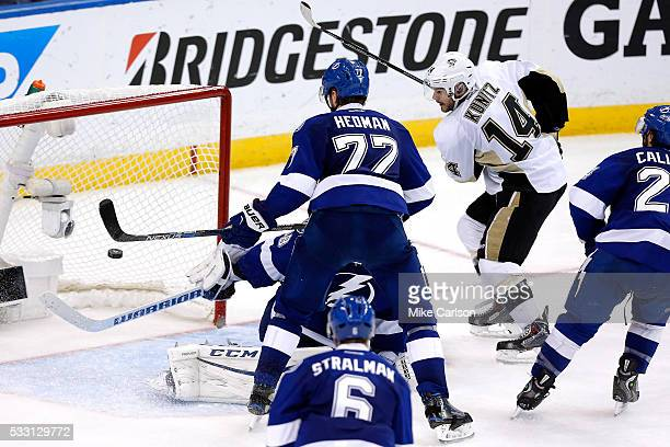 Chris Kunitz of the Pittsburgh Penguins scores the third goal against Andrei Vasilevskiy of the Tampa Bay Lightning during the third period in Game...
