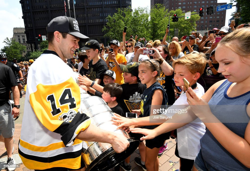 Chris Kunitz #14 of the Pittsburgh Penguins shows the Stanley Cup to fans during the Pittsburgh Penguins Victory Parade And Rally on June 14, 2017 in Pittsburgh, Pennsylvania.