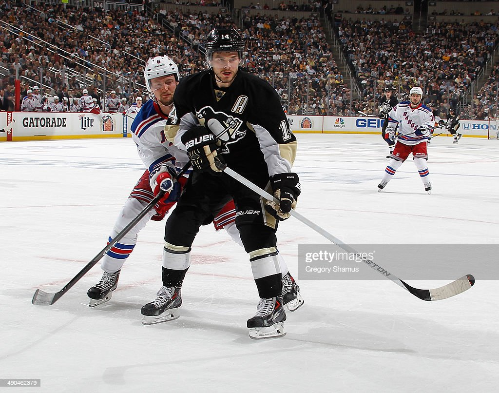 <a gi-track='captionPersonalityLinkClicked' href=/galleries/search?phrase=Chris+Kunitz&family=editorial&specificpeople=604159 ng-click='$event.stopPropagation()'>Chris Kunitz</a> #14 of the Pittsburgh Penguins skates alongside <a gi-track='captionPersonalityLinkClicked' href=/galleries/search?phrase=Anton+Stralman&family=editorial&specificpeople=2271901 ng-click='$event.stopPropagation()'>Anton Stralman</a> #6 of the New York Rangers in Game Five of the Second Round of the 2014 Stanley Cup Playoffs at Consol Energy Center on May 9, 2014 in Pittsburgh, Pennsylvania.
