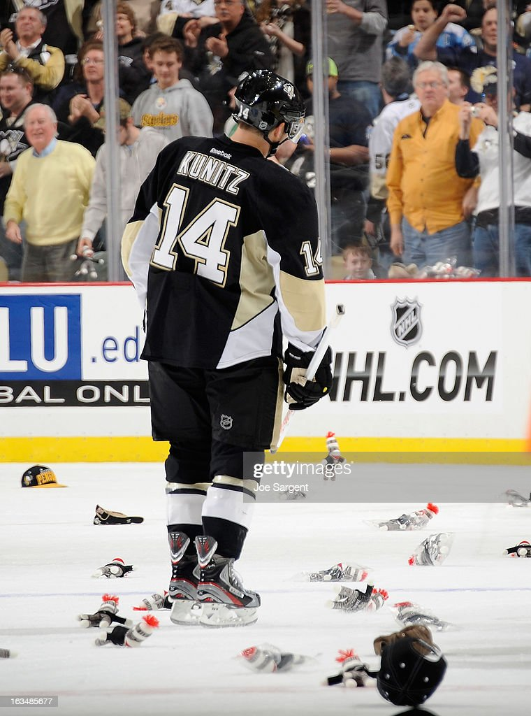 <a gi-track='captionPersonalityLinkClicked' href=/galleries/search?phrase=Chris+Kunitz&family=editorial&specificpeople=604159 ng-click='$event.stopPropagation()'>Chris Kunitz</a> #14 of the Pittsburgh Penguins skates back to the bench after scoring his hat trick goal against the New York Islanders on March 10, 2013 at Consol Energy Center in Pittsburgh, Pennsylvania. Pittsburgh won the game 6-1.