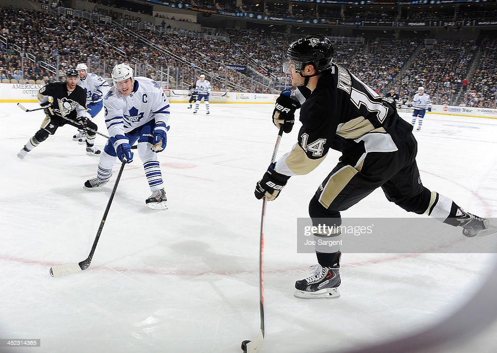 <a gi-track='captionPersonalityLinkClicked' href=/galleries/search?phrase=Chris+Kunitz&family=editorial&specificpeople=604159 ng-click='$event.stopPropagation()'>Chris Kunitz</a> #14 of the Pittsburgh Penguins takes a shot in front of <a gi-track='captionPersonalityLinkClicked' href=/galleries/search?phrase=Dion+Phaneuf&family=editorial&specificpeople=545455 ng-click='$event.stopPropagation()'>Dion Phaneuf</a> #3 of the Toronto Maple Leafs on November 27, 2013 at Consol Energy Center in Pittsburgh, Pennsylvania.