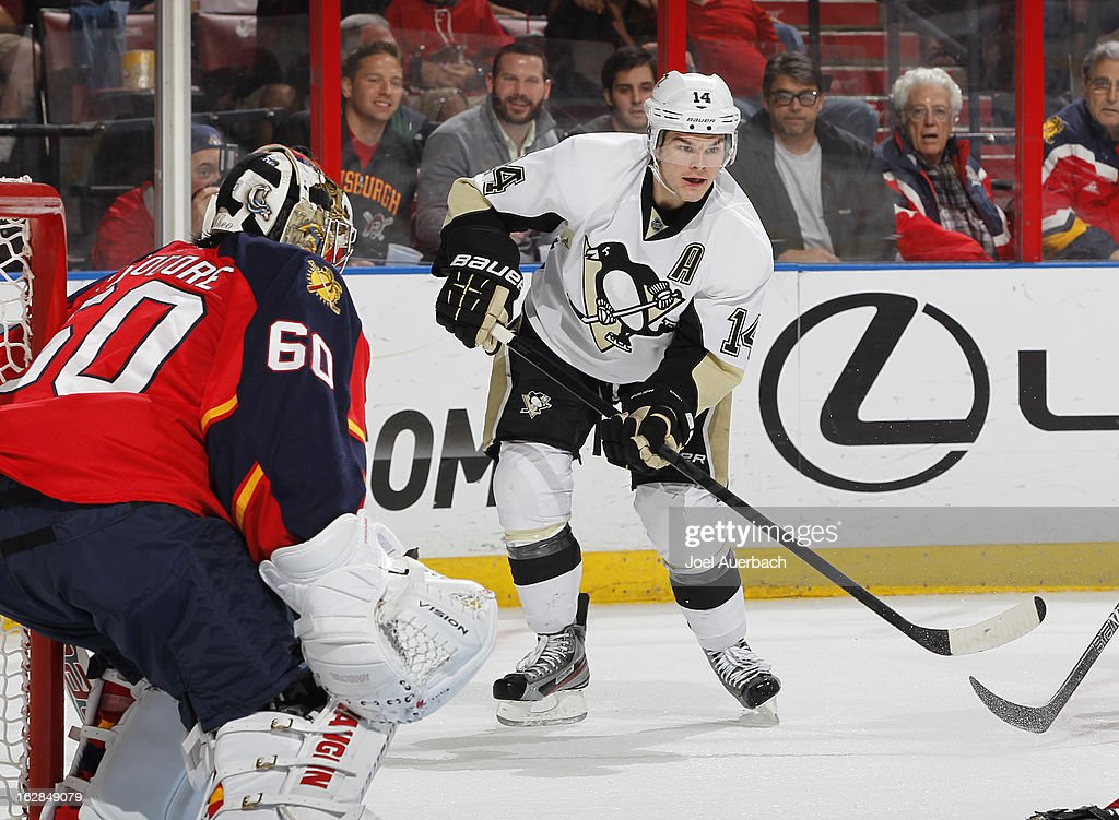 Chris Kunitz #14 of the Pittsburgh Penguins waits for a pass to the side of goaltender Jose Theodore #60 of the Florida Panthers during second period action at the BB&T Center on February 26, 2013 in Sunrise, Florida. The Panthers defeated the Penguins 6-4.