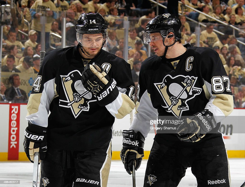<a gi-track='captionPersonalityLinkClicked' href=/galleries/search?phrase=Chris+Kunitz&family=editorial&specificpeople=604159 ng-click='$event.stopPropagation()'>Chris Kunitz</a> #14 talks with <a gi-track='captionPersonalityLinkClicked' href=/galleries/search?phrase=Sidney+Crosby&family=editorial&specificpeople=212781 ng-click='$event.stopPropagation()'>Sidney Crosby</a> #87 of the Pittsburgh Penguins during the game against the New York Rangers in Game One of the Second Round of the 2014 Stanley Cup Playoffs at Consol Energy Center on May 2, 2014 in Pittsburgh, Pennsylvania.