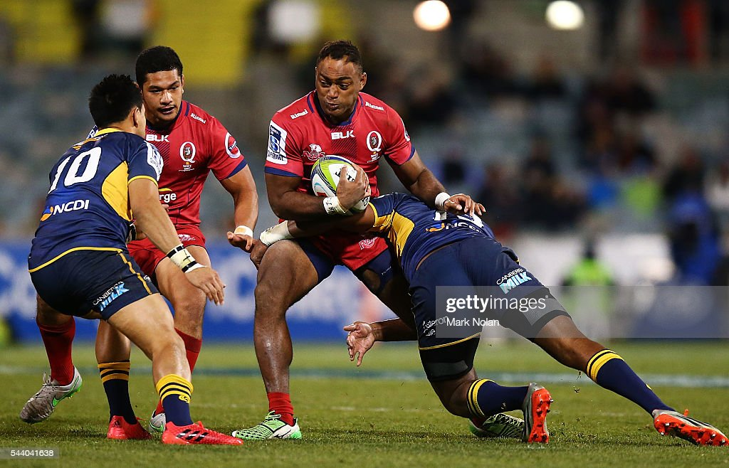 Chris Kuridrani of the Reds is tackled during the round 15 Super Rugby match between the Brumbies and the Reds at GIO Stadium on July 1, 2016 in Canberra, Australia.