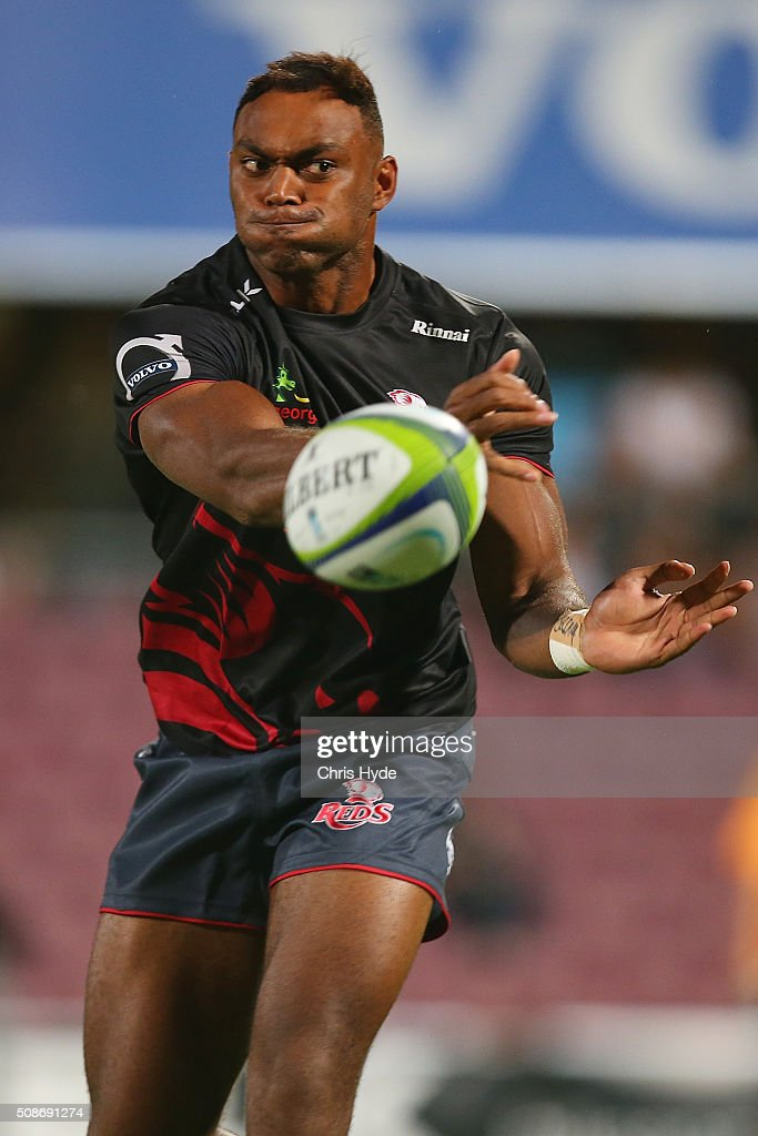 Chris Kuridrani of the Reds passes during warm up before the Super Rugby pre-season match between the Reds and the Crusaders at Ballymore Stadium on February 6, 2016 in Brisbane, Australia.