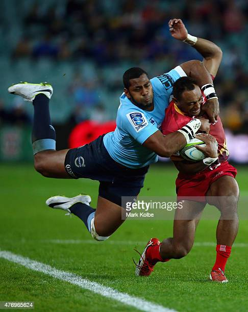 Chris Kurindrani of the Reds is tackled by Taqele Naiyaravoro of the Waratahs during the round 18 Super Rugby match between the Waratahs and the Reds...