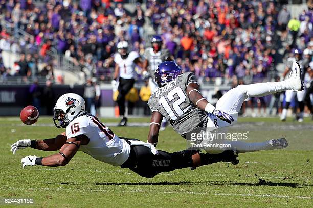 Chris Lacy of the Oklahoma State Cowboys dives for a pass against Jeff Gladney of the TCU Horned Frogs in the first half at Amon G Carter Stadium on...